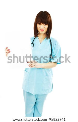 Nurse showing medical sign billboard standing. Young smiling woman nurse or doctor showing empty blank sign board with copy space. Isolated on white background. - stock photo