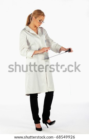 Nurse standing, taking notes and looking at medical charts - stock photo