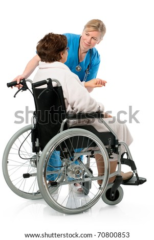 nurse with a senior patient in wheelchair - stock photo