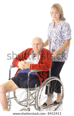 nurse with disabled elderly patient - stock photo
