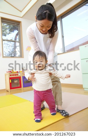 Nursery and a boy with a picture book - stock photo