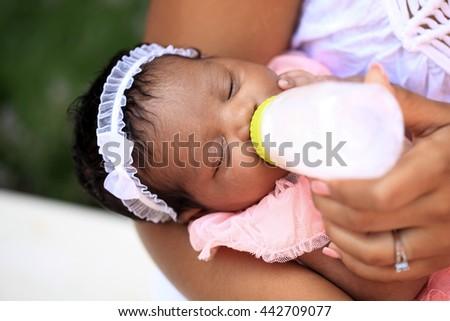 Nursing baby - stock photo