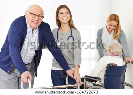 Nursing service with two women for senior couple at home - stock photo