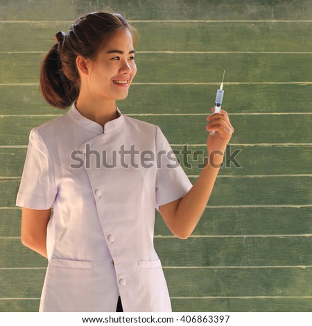 Nursing students standing at a blackboard, Nurse, Student, Education. - stock photo