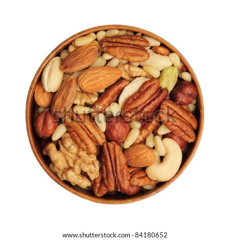 Nut mixture in a bowl - almonds, walnuts, pecans, pine nuts, pistachios, cashews - stock photo