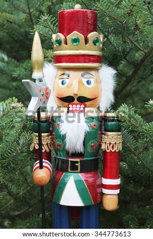nutcracker soldier and christmas tree as a background  - stock photo