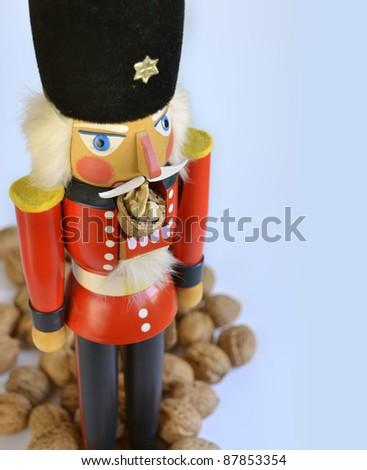 nutcracker with walnuts - stock photo
