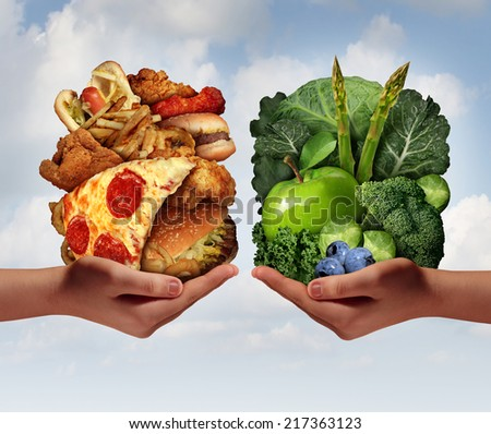 Nutrition choice and diet decision concept and eating dilemma between healthy good fresh fruit and vegetables or greasy cholesterol rich fast food with two hands holding meal options. - stock photo