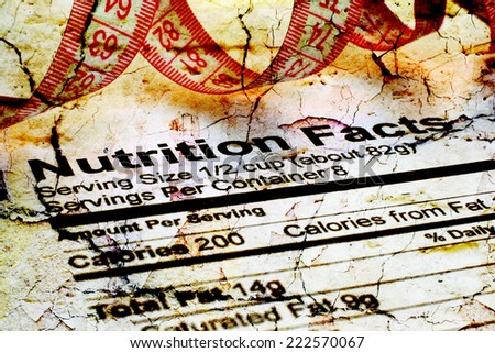 Nutrition facts and measure tape  - stock photo