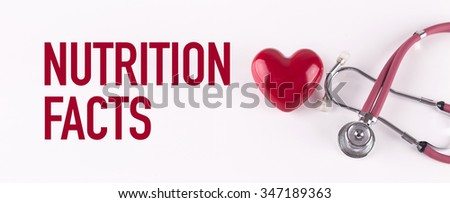 NUTRITION FACTS concept with stethoscope and heart shape - stock photo