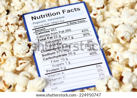 Nutrition facts of popcorn with popcorns background  - stock photo