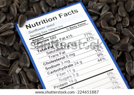 Nutrition facts of sunflower seed with sunflower seeds background  - stock photo