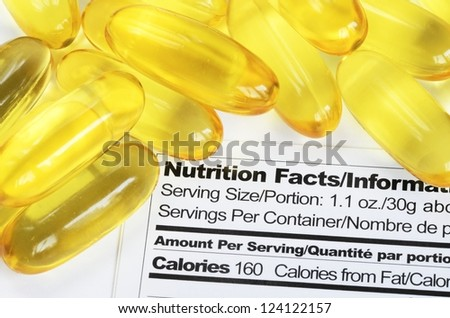 Nutrition label with fish oil pills concept healthy eating - stock photo