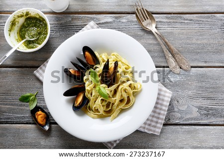 Nutritional pasta with seafood, top view - stock photo