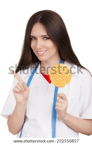 Nutritionist Saying No To Sugary Dessert - Woman nutritionist holding candy and recommending a non sugar diet   - stock photo