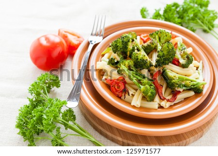Nutritious Pasta with roasted vegetables broccoli and pepper. Italian food - stock photo