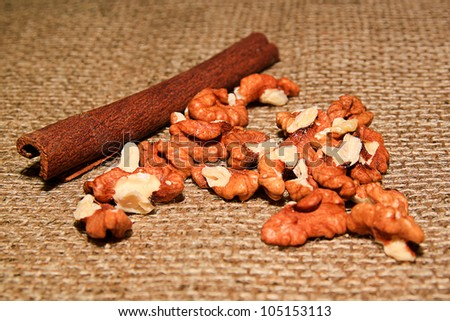 Nuts and cinnamon on the sacking - stock photo