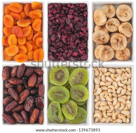 Nuts and dried fruits in ceramic plate, isolated on white background - stock photo