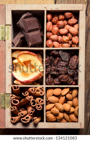 Nuts, cinnamon, raisins and dry fruits as an ingredient for dessert - stock photo