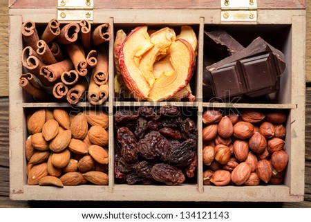 Nuts, cinnamon, raisins as an ingredient for dessert - stock photo
