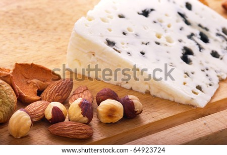 Nuts, dried apples and blue cheese - stock photo