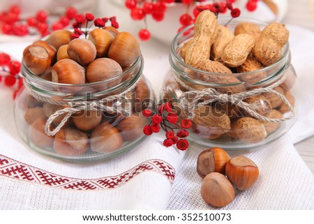 nuts in glass bowls on table - stock photo