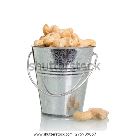 Nuts in metal bucket isolated on white background - stock photo