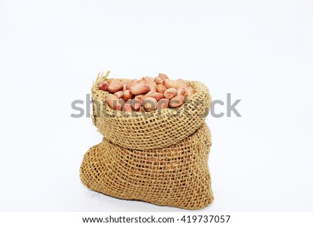 nuts in the sack cloth bag on white background - stock photo