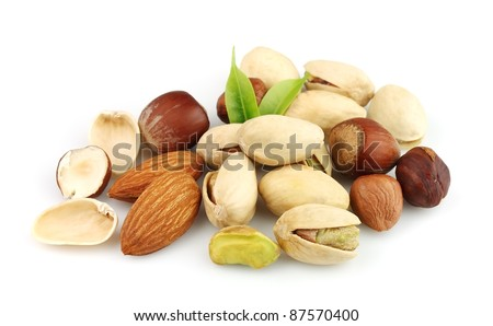 Nuts mix on the white close up - stock photo