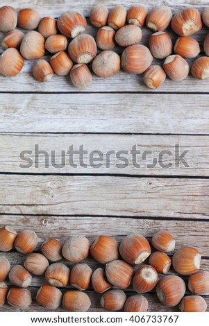 Nuts on wooden background. Frame made of nuts. Nut frame. hazelnuts. Shabby nut background. Nut frame for your text.  - stock photo