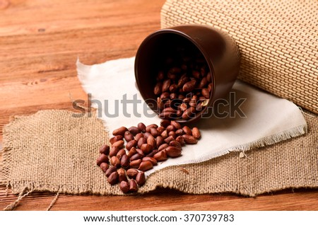 nuts scattered on a brown wooden table, close-up - stock photo