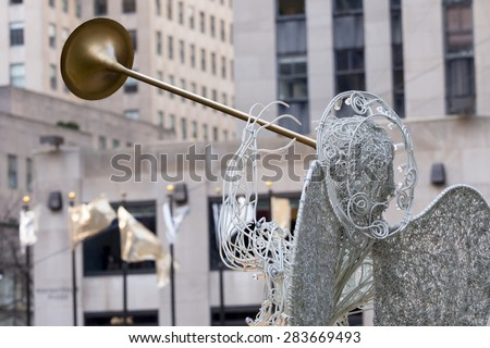 NY - Manhattan 31 dec 2014: angel close up in front the rockefeller building in christmas time - stock photo