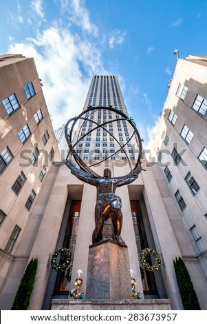 NY - Manhattan 31 dec 2014: Statue symbol in front Rockefeller building  whit clouds view from street in manhattan - stock photo