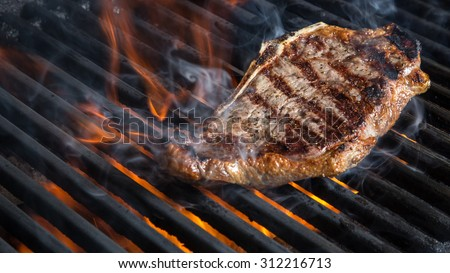 NY Strip Steak on Grill - stock photo