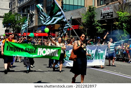 NYC - June 29, 2014:  Marchers promoting the legalization of marijuana at the 2014  Gay Pride Parade on Fifth Avenue   - stock photo
