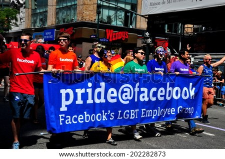 NYC  - June 29, 2014  Pride Facebook group with their blue banner at the 2014 Gay Pride Parade on Fifth Avenue   - stock photo