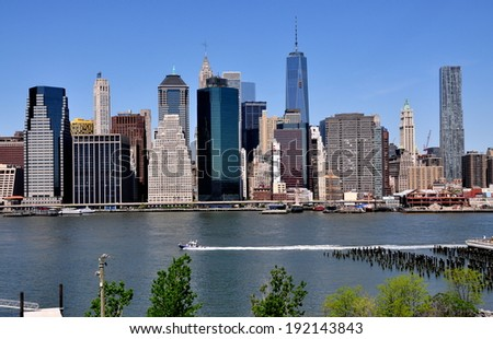 NYC - May 11, 2014:  View of lower Manhattan skyscrapers in the financial district and nearly completed One World Trade Center (with rooftop antenna) seen from the Promenade in Brooklyn Heights - stock photo