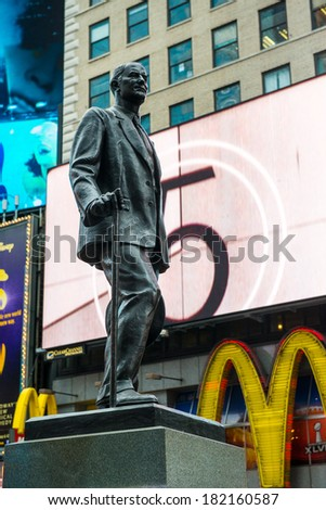 NYC, NEW YORK � CIRCA FEBRUARY 2014: A statue in front of digital signage in Times Square. - stock photo
