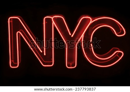 NYC New York City message in red neon on black background - stock photo