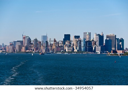 NYC Skyline as seen from ship south of Manhattan Island - stock photo