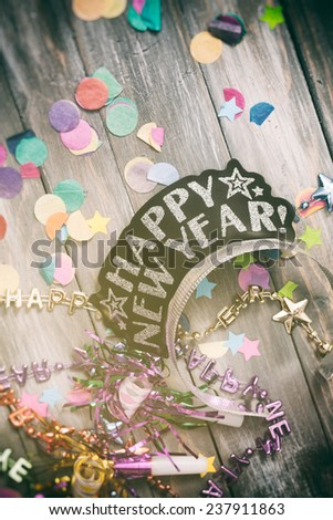 NYE Background: Happy New Year Tiara Among Party Favors - stock photo