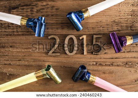 NYE Background: 2015 New Years Eve golden numbers decorations on old retro vintage aged wood backdrop Empty copy space for inscription  - stock photo