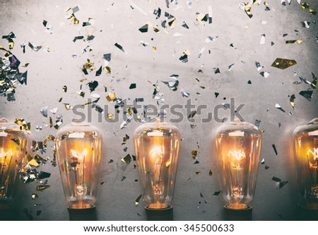 NYE: Border Of Bulbs Beneath Grungy Copy Space - stock photo