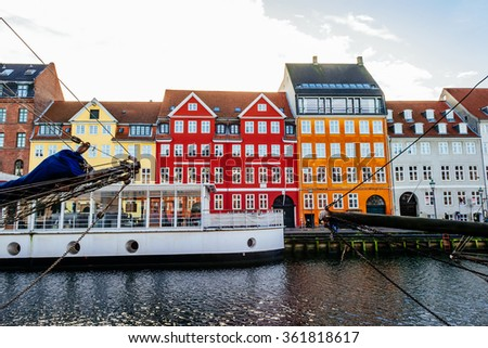 Nyhavn district is one of the most famous landmarks in Copenhagen with typical colorful houses - stock photo