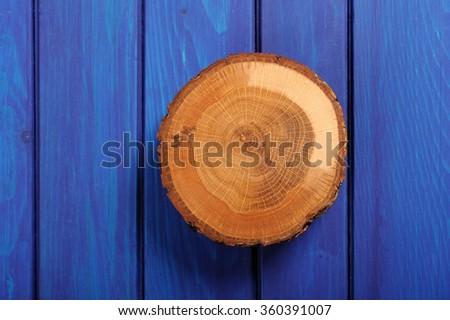 Oak cracked split on navy blue wooden table - stock photo