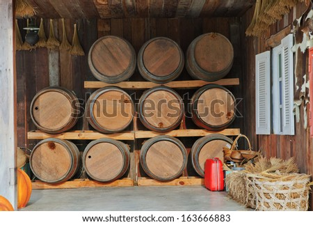 oak wood barrel tank stacked in winery house - stock photo