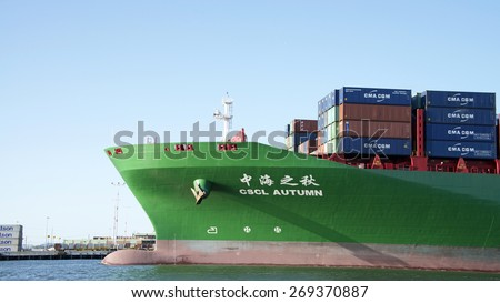 OAKLAND, CA - APRIL 12, 2015: China Shipping Line Cargo Ship CSCL AUTUMN departing the Port of Oakland. China Shipping Container Line is the seventh largest global container shipping liner by capacity - stock photo