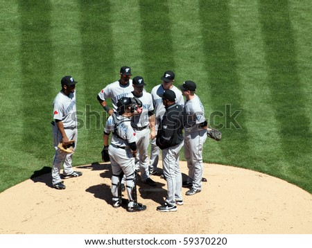 OAKLAND, CA - AUGUST 18: Blue Jays vs. Athletics: Blue Jays have a meeting on the mound with coach to discuss what to do during upcoming play.  Taken August 18 2010 at Coliseum in Oakland California. - stock photo