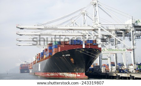 OAKLAND, CA - JANUARY 10, 2015:  American President Lines Ltd (APL) Cargo Ship JAPAN loading at the Port of Oakland. APL is the world's seventh largest container transportation and shipping company. - stock photo
