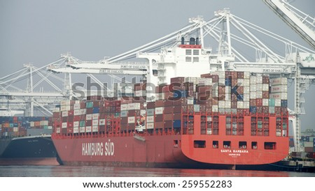 OAKLAND, CA - MARCH 10, 2015: Hamburg SUD Cargo Ship SANTA BARBARA loading at the Port of Oakland. Hamburg SUD is one of the key carriers on the North-South trade routes by ocean Transportation. - stock photo